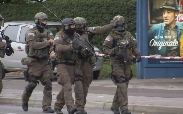 A scrren grab taken from video footage shows special forces police officers walking along a street outside the Olympia shopping mall following a shooting rampage in Munich. Reuters