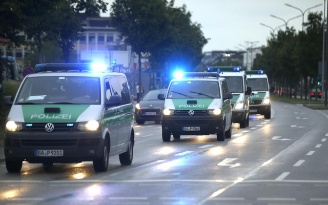 Police make their way to the scene of a shooting rampage at the Olympia shopping mall in Munich. Reuters