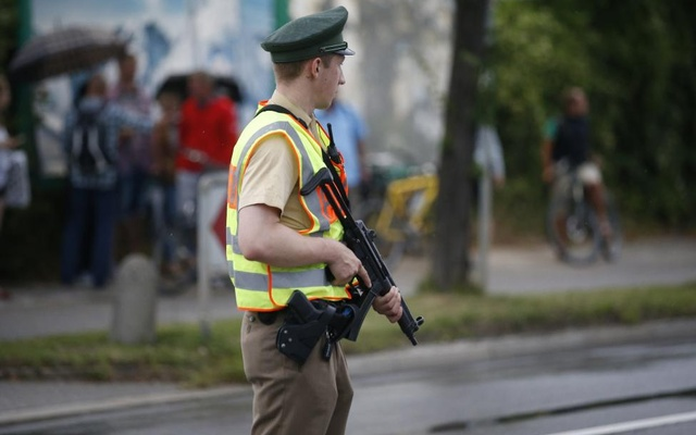A police officer secures a road near to the scene of a shooting rampage at the Olympia shopping mall in Munich. Reuters