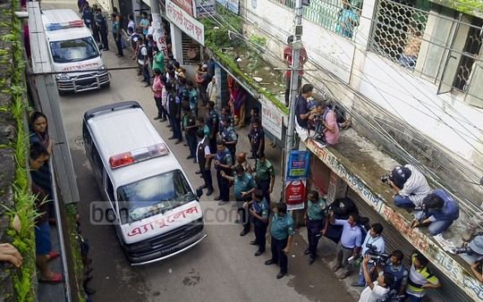 Ambulances carrying the bodies of the 'militants' leave the area. Photo: abdul mannan