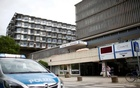 A police car is parked in front of the university clinic in Steglitz, a southwestern district of Berlin, July 26, 2016 after a doctor had been shot at and the gunman had killed himself. Reuters