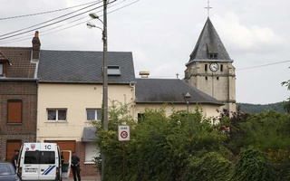 Police at the scene after two assailants had taken five people hostage in the church at Saint-Etienne-du -Rouvray near Rouen in Normandy, France,July 26, 2016. Reuters