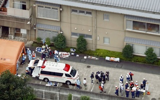 Police officers and rescue workers are seen in a facility for the disabled, where at least 19 people were killed and as many as 20 wounded by a knife-wielding man, in Sagamihara, Kanagawa prefecture, Japan, in this photo taken by Kyodo July 26, 2016. Mandatory credit Kyodo/via REUTERS