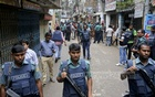 Police surround the area during a raid conducted on a militant hideout in Dhaka's Kalayanpur on Tuesday.