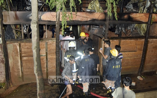 Fire Service workers try to put out a fire that broke out at the Taraka Restaurant in Dhaka's Banani on Wednesday.