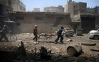 Men transport a casualty at a site hit by airstrikes in the rebel held Douma neighbourhood of Damascus, Syria, July 25, 2016. Reuters