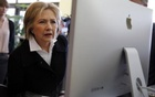 Democratic presidential candidate Hillary Clinton looks at a computer screen during a campaign stop at Atomic Object company in Grand Rapids, Michigan, US, March 7, 2016. Reuters