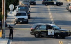 San Diego police officers investigate the scene where an officer was fatally shot and another was injured at a traffic stop late on Thursday, in San Diego, California, US, July 29, 2016. Reuters