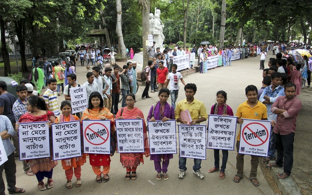 Teachers join students in anti-militancy human-chain programme in front of Aparajeyo Bangla sculpture at the Dhaka University. Photo: Asif Mahmud Ove