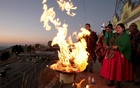 Bolivian Aymara people attend a ceremony to make offerings for the