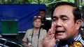 Thai Prime Minister Prayuth Chan-ocha talks to the media at a polling station during a constitutional referendum vote in Bangkok, Thailand, August 7, 2016.reuters=