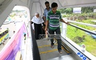 Pedestrians use escalator at an footbridge in Dhaka in front of Shahjalal International Airport on Wednesday.