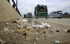 This photo shows garbage soaked with rainwater on Banani Flyover on Wednesday. Photo: mostafigur rahman