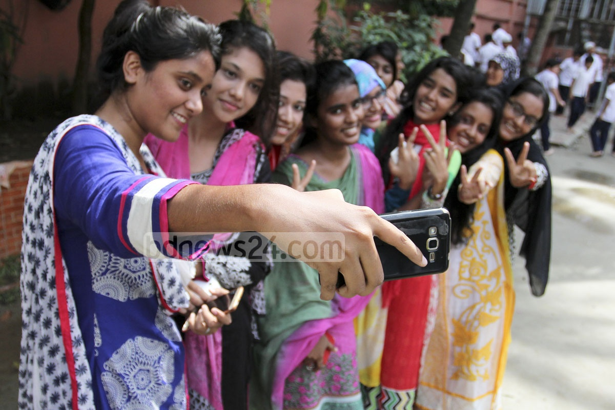 A group of students of Motijheel Ideal School and College take an usie after passing the HSC exams with flying colours on Thursday. Photo: asif mahmud ove