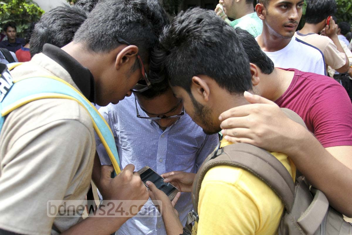 Students at Notre Dame College look for their roll numbers on mobile devices after HSC results were released on Thursday. Photo: asif mahmud ove