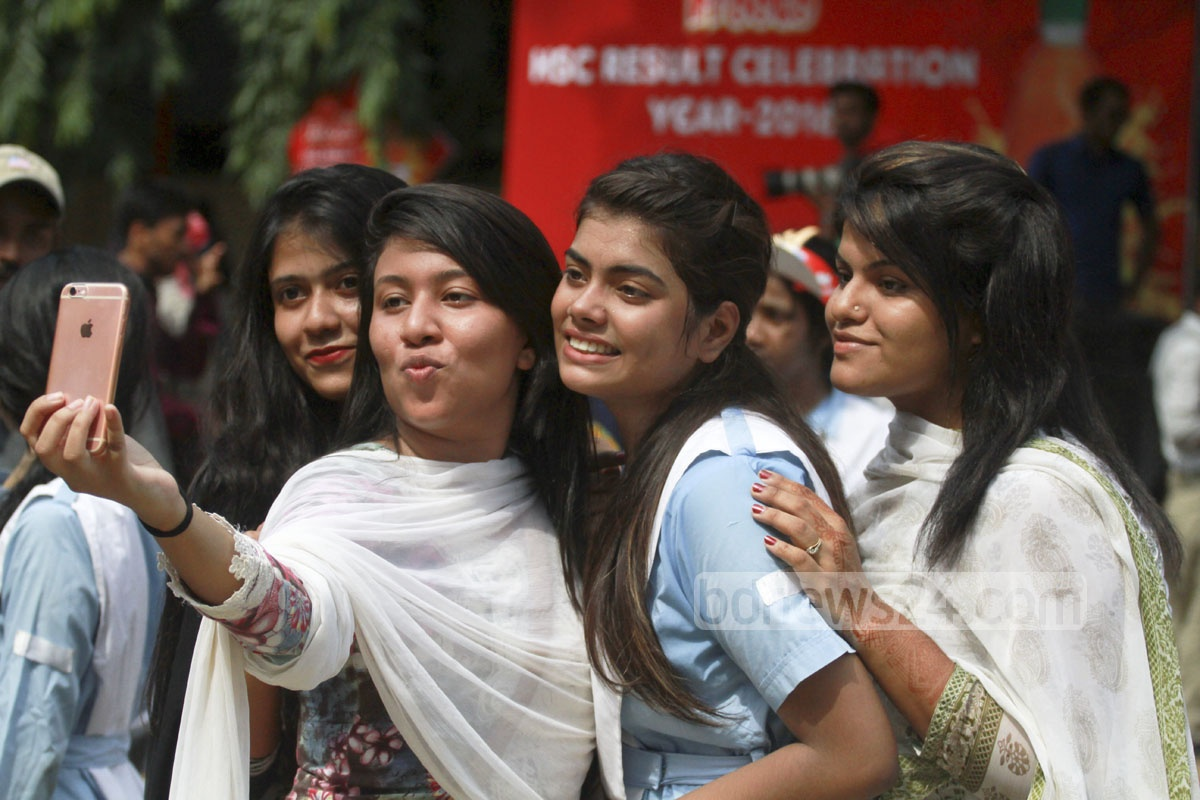 A group of students of Viqarunnisa Noon School and College take an usie after passing the HSC exams with flying colours on Thursday.