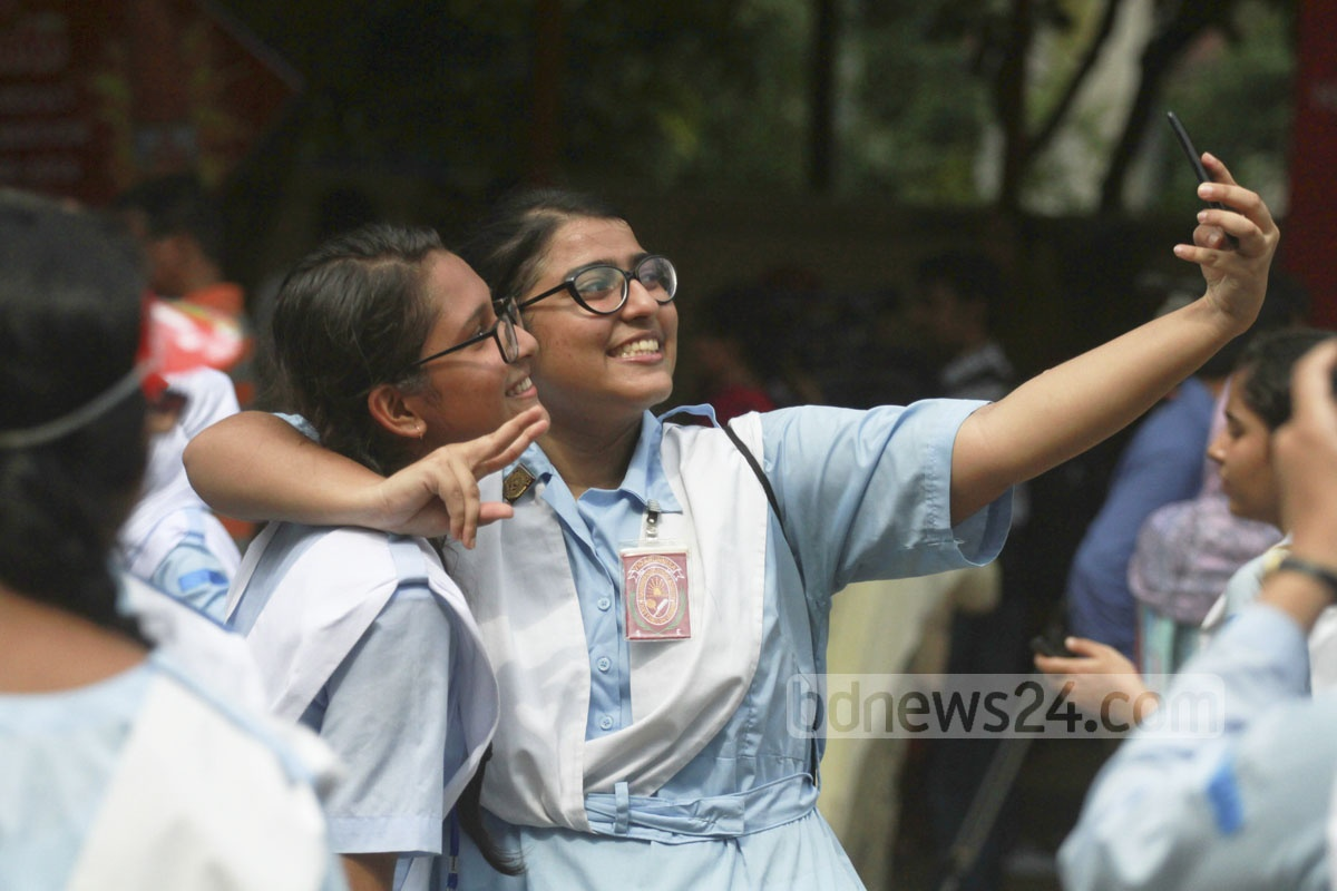 A group of students of Viqarunnisa Noon School and College take an usie after passing the HSC exams with flying colours on Thursday. Photo: abdul mannan