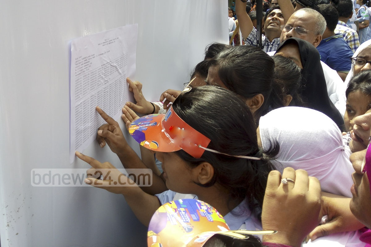 Students at Viqarunnisa Noon School and College search for their roll numbers on the result board on Thursday. Photo: abdul mannan