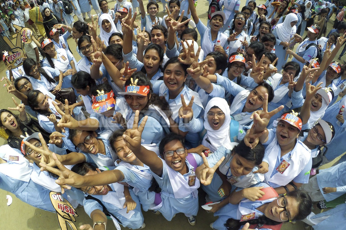 Students of Viqarunnisa Noon School and College flash the victory sign after scooping GPA-5. The results of the HSC and equivalent exams were published on Thursday . Photo: abdul mannan