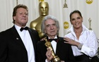 Arthur Hiller (C) holds his Jean Hersholt Humanitarian Award while standing with Ryan O'Neal (L) and Ali McGraw (R) during the 74th annual Academy Awards in Hollywood, California, U.S. March 24, 2002. Reuters