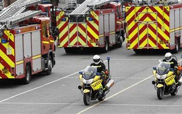 This Reuters file photo shows firefighters ride past conventional fire appliances on their fire fighting motorcycles during a training exercise in Liverpool, July 23, 2010.