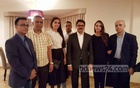 This June 23, 2015 foreign ministry photo shows Margarita Mamun's family with Shahriar Alam in Russia.
