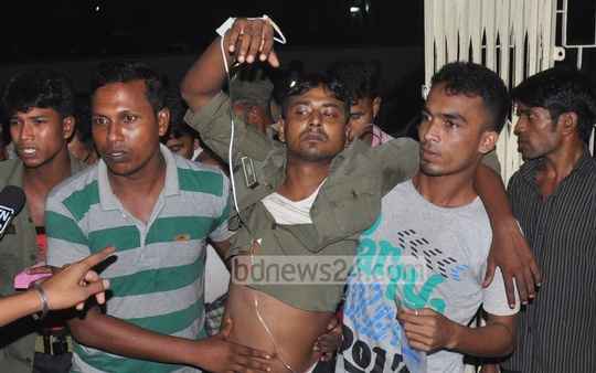 One of the people who fell sick after inhaling gas leaking from a tank of a fertiliser factory in Chittagong's Anwara being taken inside Chittagong Medical College Hospital on Monday night.