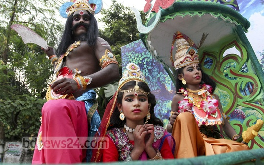Hindu boys and girls dressed up as Lord Sri Krishna and his consorts at a procession taken out from Dhakeshwari National Temple in Dhaka to celebrate the Janmashtami on Thursday . Photo: asif mahmud ove