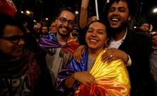 People celebrate after Colombia's government and Revolutionary Armed Forces of Colombia (FARC) rebels reached a final peace deal on Wednesday to end a five-decade war, in Bogota, Colombia, August 24, 2016. Reuters