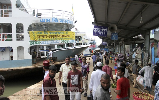 People walk at Sadarghat launch terminal on Friday amidst a strike enforced by water transport workers for a hike in wages and allowances. Photo: asif mahmud ove