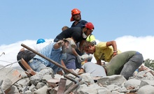 Rescuers work following an earthquake in Amatrice, central Italy August 24, 2016. Picture taken August 24, 2016. Reuters