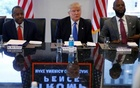 Dr. Ben Carson (L) and Republican presidential nominee Donald Trump (C) and Pierry Benjamin (R) attend a round table with the Republican Leadership Initiative at Trump Tower in the Manhattan borough of New York,, U.S., August 25, 2016. Reuters