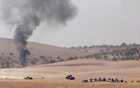 Turkish army tanks and Turkish-backed Syrian fighters make their way in the Syrian border town of Jarablus as it is pictured from the Turkish town of Karkamis, in the southeastern Gaziantep province, Turkey. Reuters