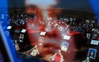 People attending a joint burial ceremony of ethnic Albanians who went missing during the 1998-1999 Kosovo war are seen in a reflection as they mark the International Day of the Disappeared in Kosovo Polje near Pristina August 30, 2010. Reuters
