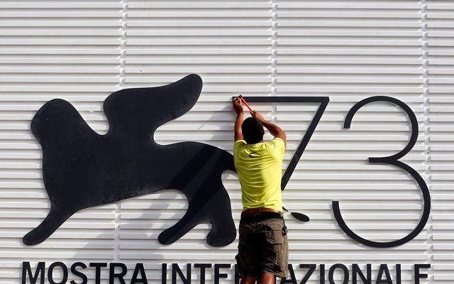 A worker sets a sign before the 73rd Venice Film Festival in Venice, August 30, 2016. Reuters
