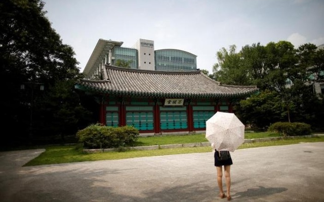 A student stands in front of Bicheondang at the Sungkyunkwan University in Seoul, South Korea, August 1, 2016. Reuters