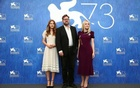 Director Martin Koolhoven poses with actresses Dakota Fanning (R) and Emilia Jones (L) as they attend the photocall for the movie ''Brimstone'' at the 73rd Venice Film Festival in Venice, Italy September 3, 2016. Reuters