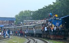 Thousands riding the roof of a train at Airport Railway Station on Thursday to celebrate the Eid-ul-Azha with their families back home in towns and villages. Photo: mostafigur rahman