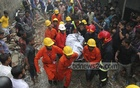 Rescuers carry away the body of a worker killed in a boiler explosion and fire at packaging firm Tampaco Foils Limited's factory in Gazipur's Tongi on Saturday.