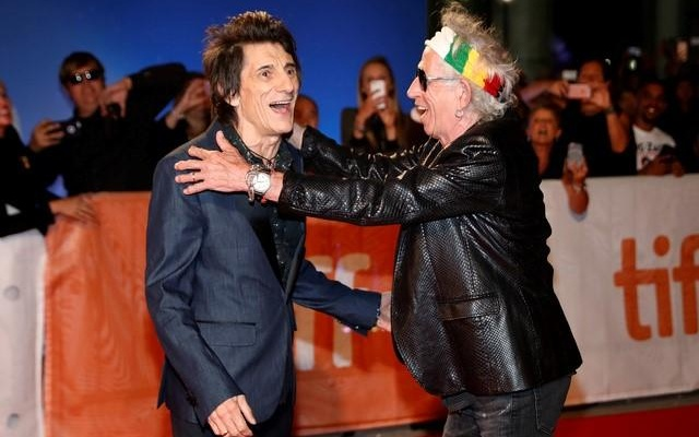 Keith Richards greets fellow bandmate Ronnie Wood on the red carpet for the film The Rolling Stones Ole Ole Ole! : A Trip Across Latin America. Reuters