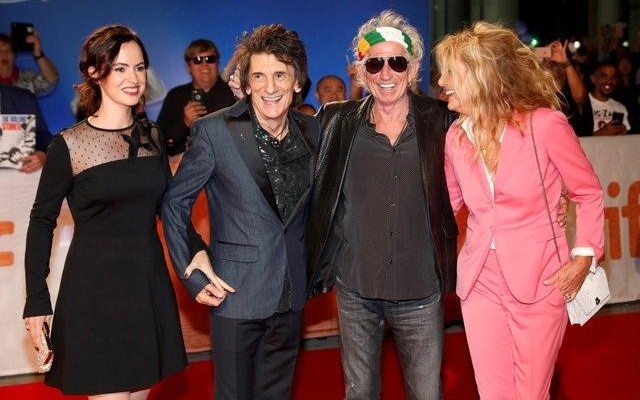 Keith Richards (2nd R) arrives with his wife Patti Hansen and fellow bandmate Ronnie Wood (L) and his wife Sally Humphreys on the red carpet for the film 'The Rolling Stones Ole Ole Ole! : A Trip Across Latin America' during the 41st Toronto International Film Festival (TIFF), in Toronto, Canada, September 16, 2016. Reuters