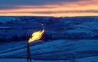 A natural gas flare on an oil well pad burns as the sun sets outside Watford City, North Dakota, January 21, 2016. Reuters​