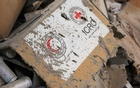 Damaged Red Cross and Red Crescent medical supplies lie inside a warehouse after an airstrike on the rebel held Urm al-Kubra town, western Aleppo city, Syria September 20, 2016. Reuters