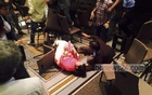 A woman falls to the ground as the Awami League's USA unit rivals bickered after Prime Minister Sheikh Hasina left a reception accorded to her in New York on Wednesday (local time).
