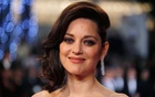 Marion Cotillard poses on the red carpet as she arrives for the screening of the film 'Juste la fin du monde' (It s Only the End of the World) at the 69th Cannes Film Festival in May 2016. Reuters