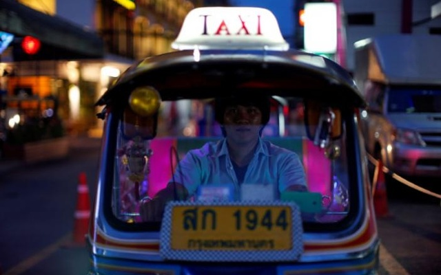 A tuk-tuk (three-wheeler) driver is pictured in Bangkok, Thailand, Sept 14, 2016. Reuters