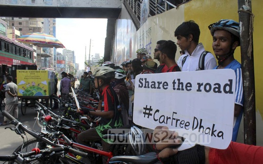A group of cyclists demonstrate in front of the National Press Club on Saturday to mark World Car Free Day.
