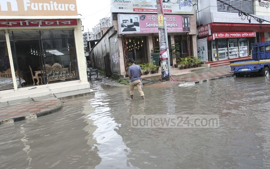 Parts of Rokeya Sarani in Kaziparha, Mirpur, go under knee-deep water with a splash of rain. Water-logging is a common problem in the area for the past several years with little effort from authorities to resolve the issue. The photo was taken on Saturday.