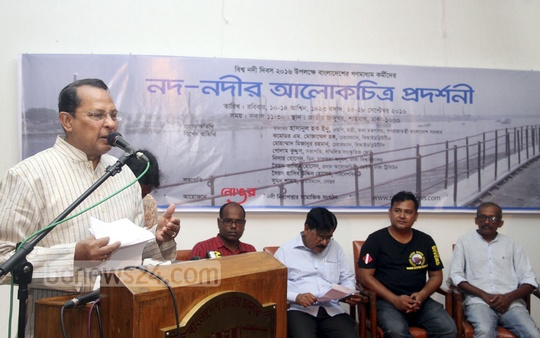 Information Minister Hasanul Haq Inu speaks as chief guest at the inaugural ceremony of a photo exhibition on rivers by 'Nongor' at the National Museum on Sunday to mark World Rivers Day.