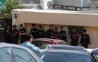 Jordanian police stand guard in front of a hospital where the body of Jordanian writer Nahed Hattar, who was shot dead, was held in Amman, Jordan, September 25, 2016. Reuters